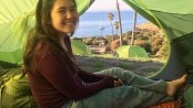 Angeleia Do of girls Troop 606 of Irvine, Calif., sits in her tent during a backpacking trek along the Trans-Catalina Trail.